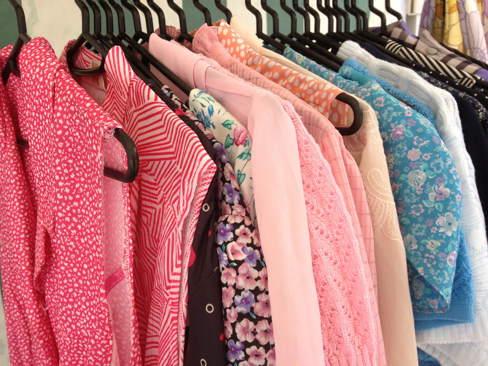 Vintage polyester clothes on rail
